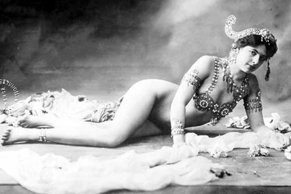 black and white photo of Mata Hari reclining in stage attire