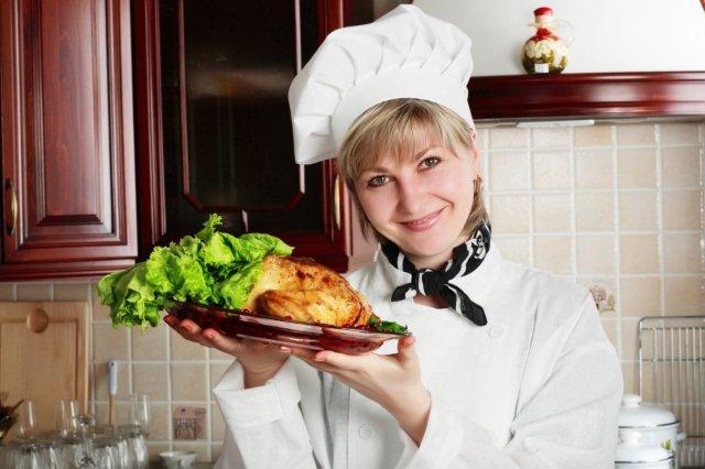 female personal chef holding a roast