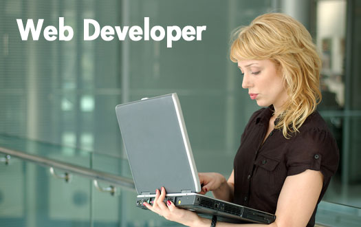 female web developer holding a laptop