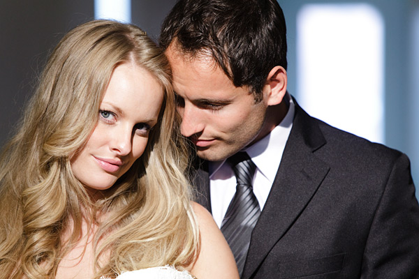 couple consisting of man in suit and blonde woman