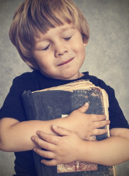 Contradictions in the Bible, boy hugging book.