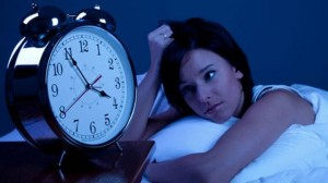 A woman facing sleeping issues, insomnia sign for burnout