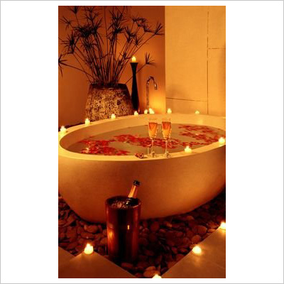 Bathtub with candles and champagne