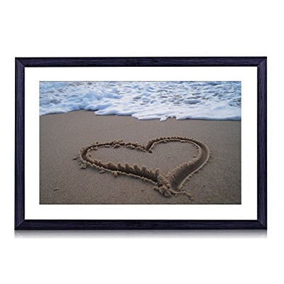 art frame with heart in sand