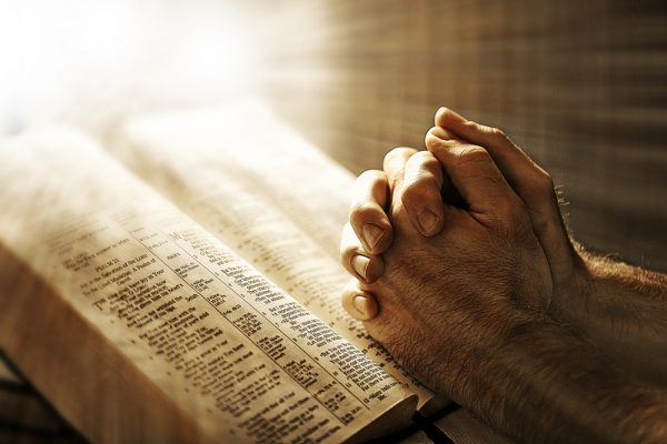 contradictions in the bible, hands praying, bible