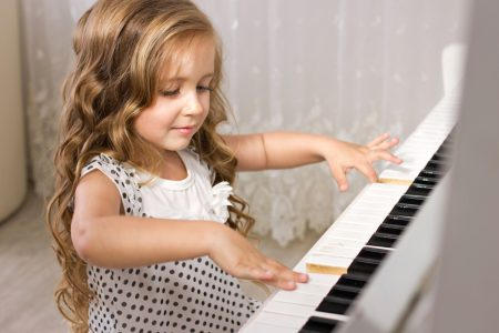 Beautiful Little girl playing the piano