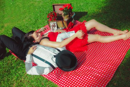 Couple lying on a picnic cloth