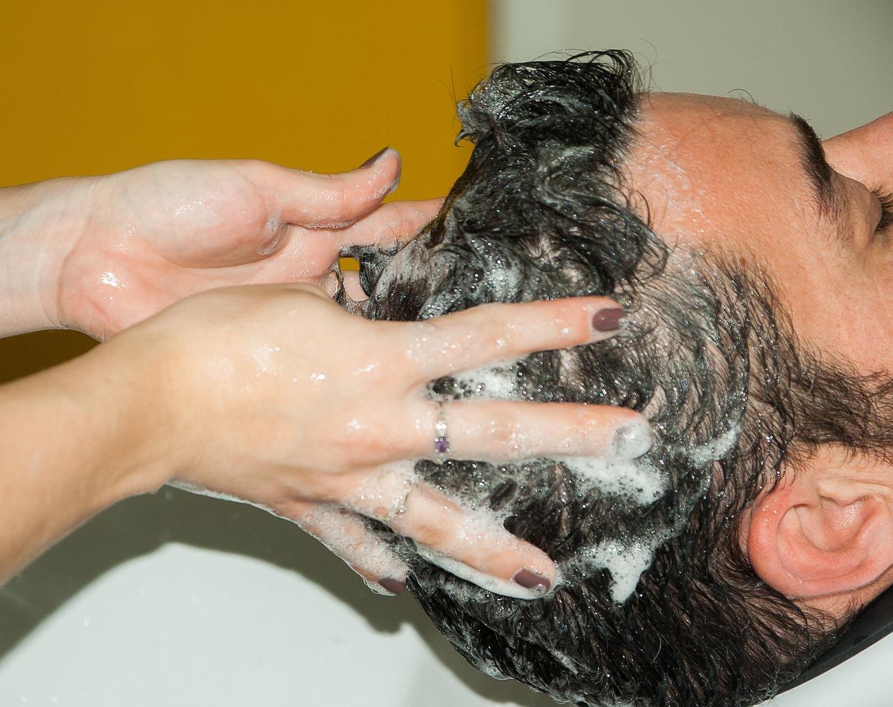 woman applying shampoo