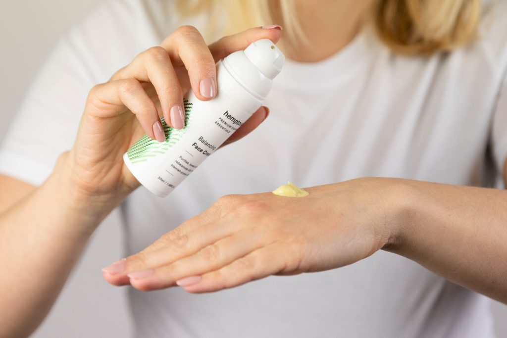 a woman trying a skincare product on her hand